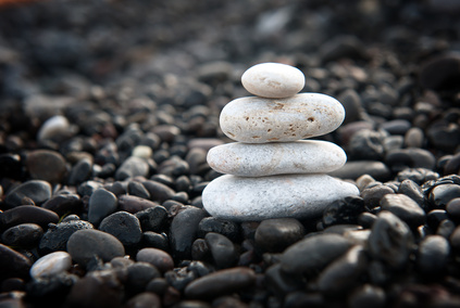 zen garden with stone stack